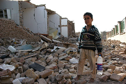Boy in ruined building after the 2004 earthquake in Bam